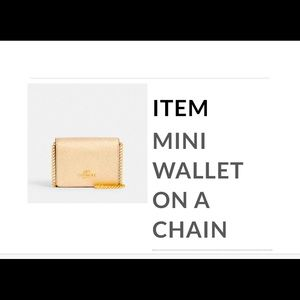 NWOT Coach Mini wallet with Gold Chain.